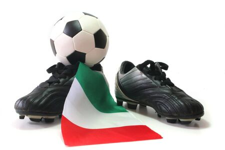 soccer shoes: flag of Italy with soccer shoes and football Stock Photo