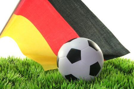 soccer wm: Flag of Germany with a football in a field