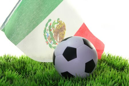 soccer wm: Flag of Mexico with a football in a field Stock Photo