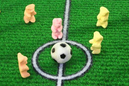 Gummi Bears play football on a soccer field Stock Photo - 7091853