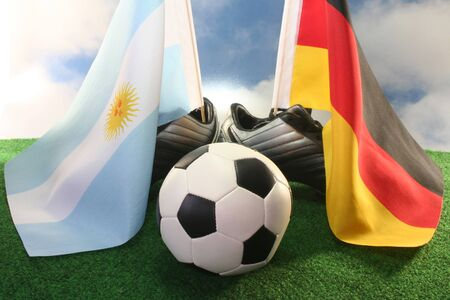 soccer wm: Flag of Argentina and Germany, with football in a field