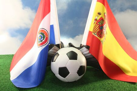 soccer wm: Flag of Paraguay and Spain, with football in a field