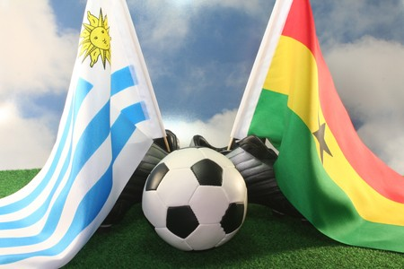 soccer wm: Flag of Uruguay and Ghana, with football in a field