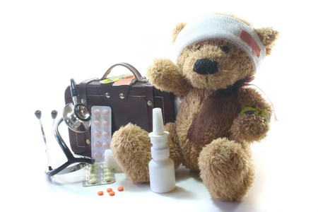 prevented: Kids first aid kit with Teddy, Bags, Stethoscope and medicines Stock Photo