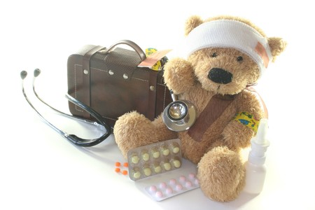 leave: Kids first aid kit with Teddy, Bags, Stethoscope and medicines Stock Photo