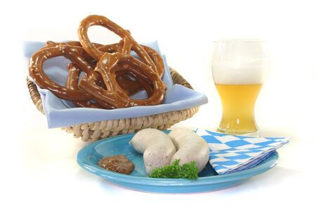 sweet mustard: veal sausage with sweet mustard and pretzels on a white background