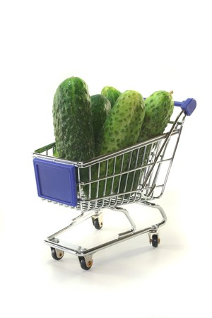 Gherkins in a shopping cart on a white background Stock Photo - 7327875