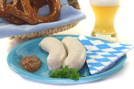 veal sausage: Veal sausage with sweet mustard and pretzels on a white background