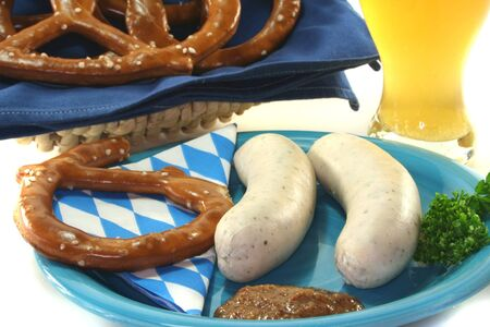 Veal sausage with sweet mustard and pretzels on a white background photo