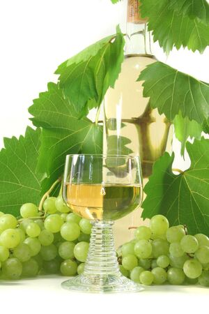 a glass of white wine with bottle, grapes and leaves Stock Photo - 7434922