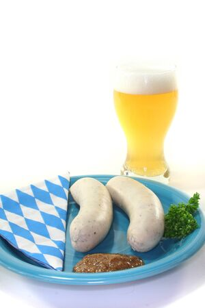 veal sausage: veal sausage with sweet mustard on a white background