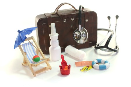 travel symbol: First aid kit with Bags, Stethoscope and medicines Stock Photo