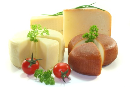 dairy: various Cheese with fresh tomatoes and herbs Stock Photo