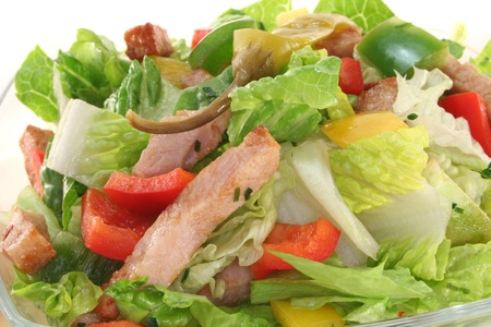 salad dressing: Mixed salad with turkey strips and fresh herbs Stock Photo