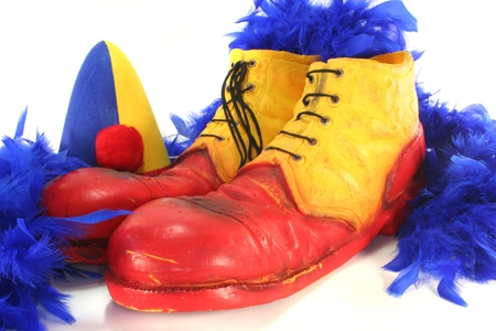 feather boa: red and yellow clown shoes with blue feather boa and Harlequin hat