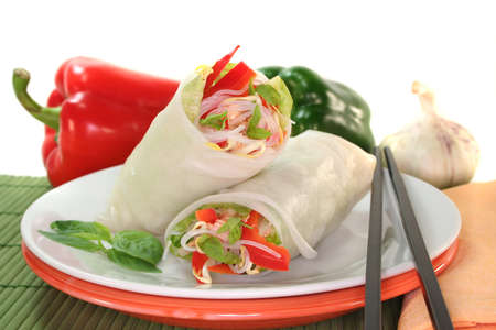 Lucky roll with lettuce, salmon, rice noodles, bell peppers and Thai basil photo