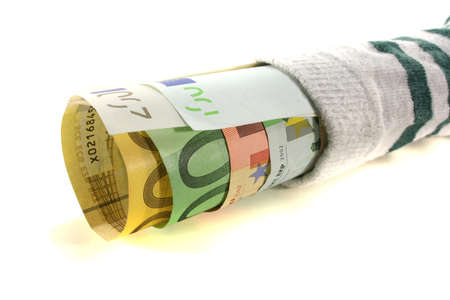 Striped money sock with many euro notes on a white background Stock Photo - 8832288