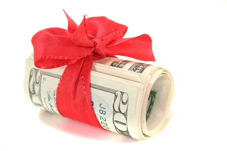 donations: many dollar bills with a red bow on white background