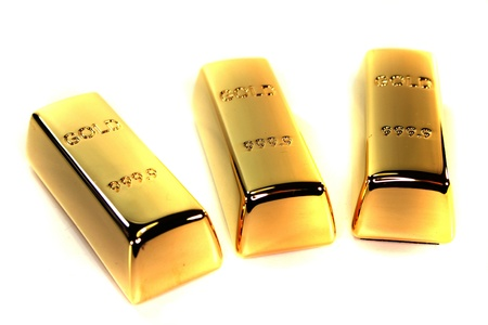three large gold bars on a white background photo