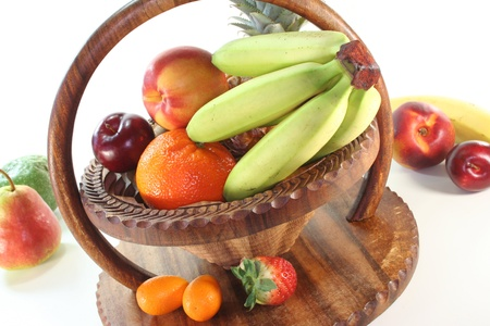 Mix of native and exotic fruits in a wooden basket photo