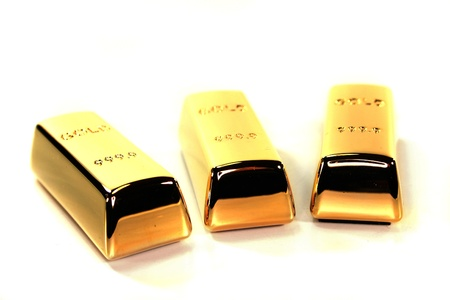 three large gold bars on a white background Stock Photo - 8920576