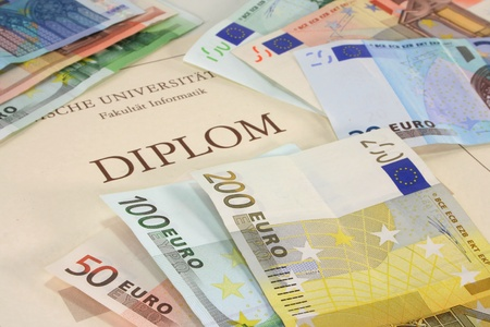 examiert: purchased diploma - diploma certificate with many euro notes Stock Photo