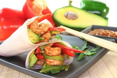 Asian Wrap with king prawns, avocado, red peppers and arugula photo