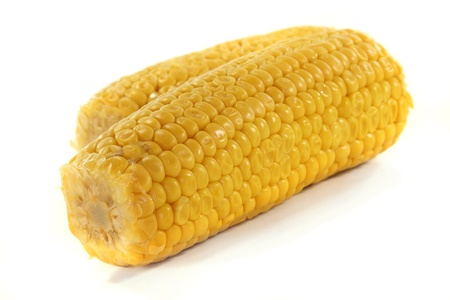 two yellow corn on a white background Stock Photo - 9129609