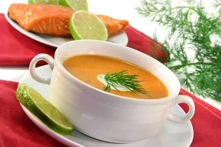 dollop: Salmon cream soup with a dollop of cream and dill Stock Photo