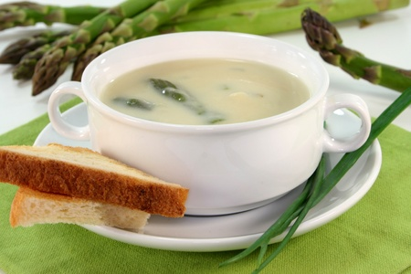 Asparagus cream soup with fresh asparagus, toast and chive