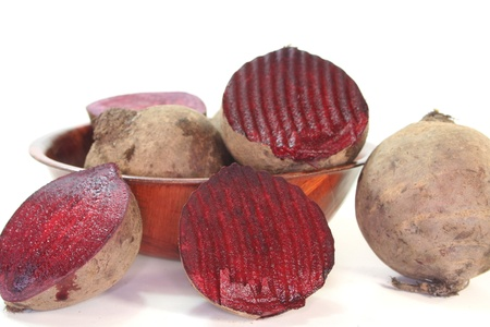 formulation: fresh beet root in a wooden bowl on a white background Stock Photo