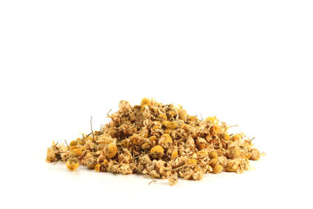 catarrh: dried yellow chamomile flowers on a white background
