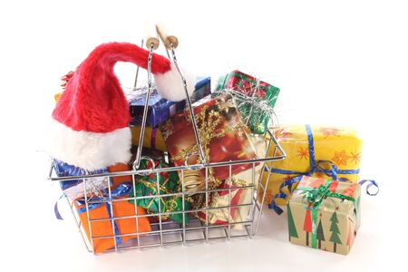 christmas budget: Christmas gifts in the shopping basket with Santa Hat