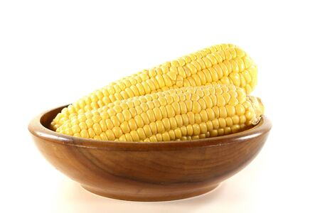 corncob: two corncob in a wooden bowl on a white background