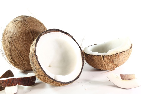 fresh coconut with coconut meat on a white background
