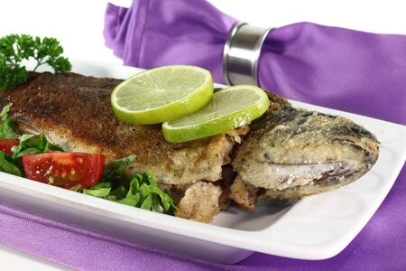 brook trout: fresh trout Miller with lettuce, tomatoes and lime
