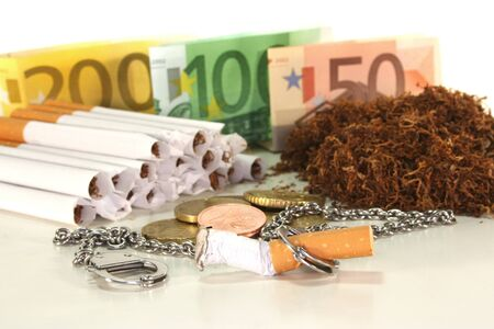 subsidy: Euro notes and coins with cigarettes on a white background Stock Photo