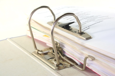 secretarial: open folder with documents filed on a white background Stock Photo