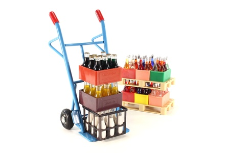 sack truck: sack truck with cola, lemonade, milk and beverages stacked on euro pallets in the background