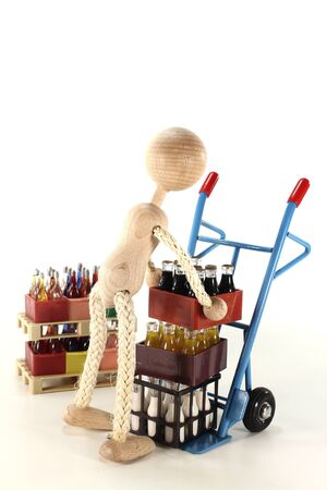 sack truck: doll loads sack truck with cola, lemonade, milk and beverages stacked on euro pallets in the background