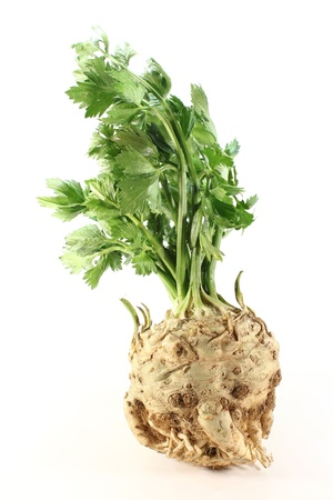 whole celery with green leaves on white background Standard-Bild