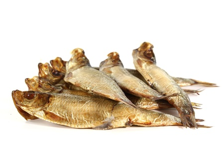 sprats: handful of smoked sprats on a white background Stock Photo