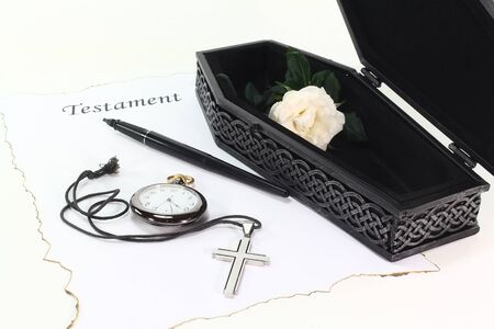 statutory: Testament with an open coffin, a white rose, clock, pen and cross Stock Photo