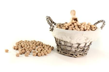 bushel: fresh yellow dried chick peas in a basket with bushel