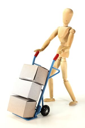 wooden figure: Hand truck with different packages and wooden figure on a white background