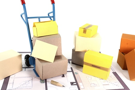 sack truck: Moving boxes with a hand truck, paper and floor plan