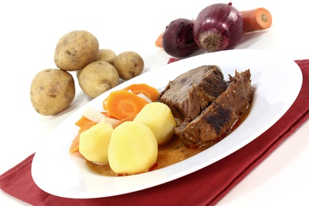 Slices of braised Roast beef with roast potatoes, carrots and gravy Stock Photo - 11770133