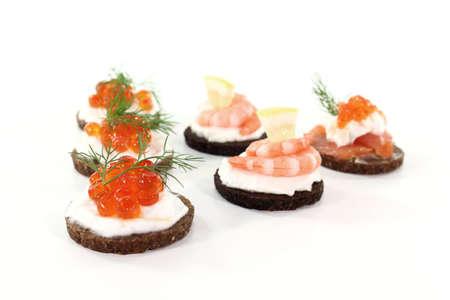 pumpernickel: Pumpernickel bread with cream cheese, salmon, caviar and shrimp Stock Photo