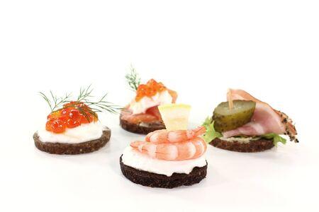 smoked bacon: Pumpernickel bread with cream cheese, shrimp, caviar, salmon and smoked bacon Stock Photo