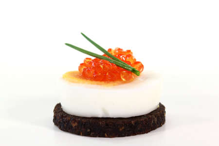 pumpernickel: Pumpernickel bread with boiled egg, caviar and fresh chives